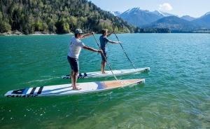 Two men paddle boarding