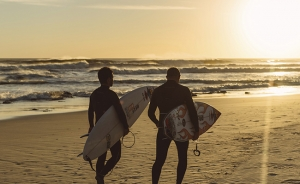 surfers and a sunset